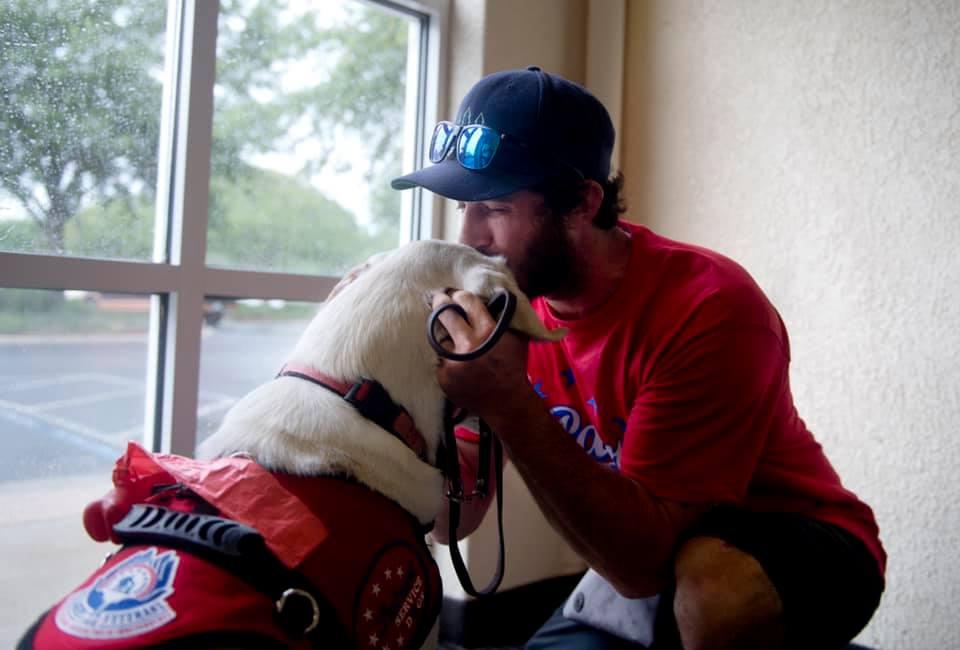 veteran kissing dog